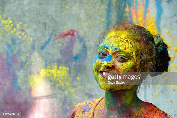 an indian young girl celebrating holi festival.india. - body paint stock pictures, royalty-free photos & images