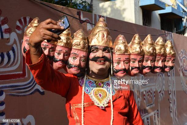 An Indian young man dressed as Raban take Selfie her moile camera on prior to participating in a religious rally to celebrate the Gajan Festival in...