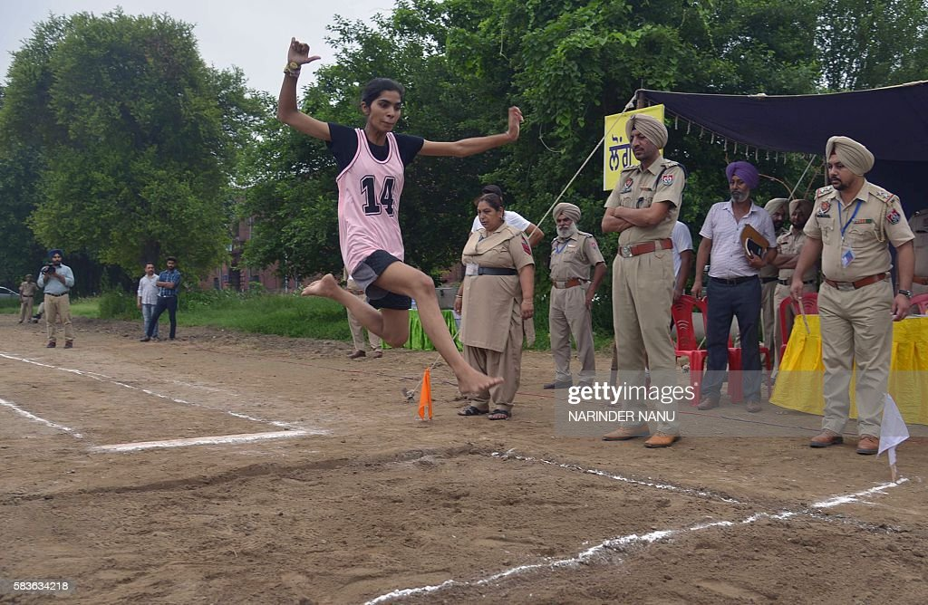 An Indian young woman takes part in a long jump event for a physical fitness test to join the Punjab police during a recruitment drive in Amritsar on.