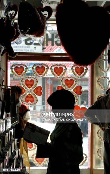An Indian youth browses through Valentine Day cards in a shop in Calcutta 10 February 2004 Hindu nationalists claim the Western holiday promotes...