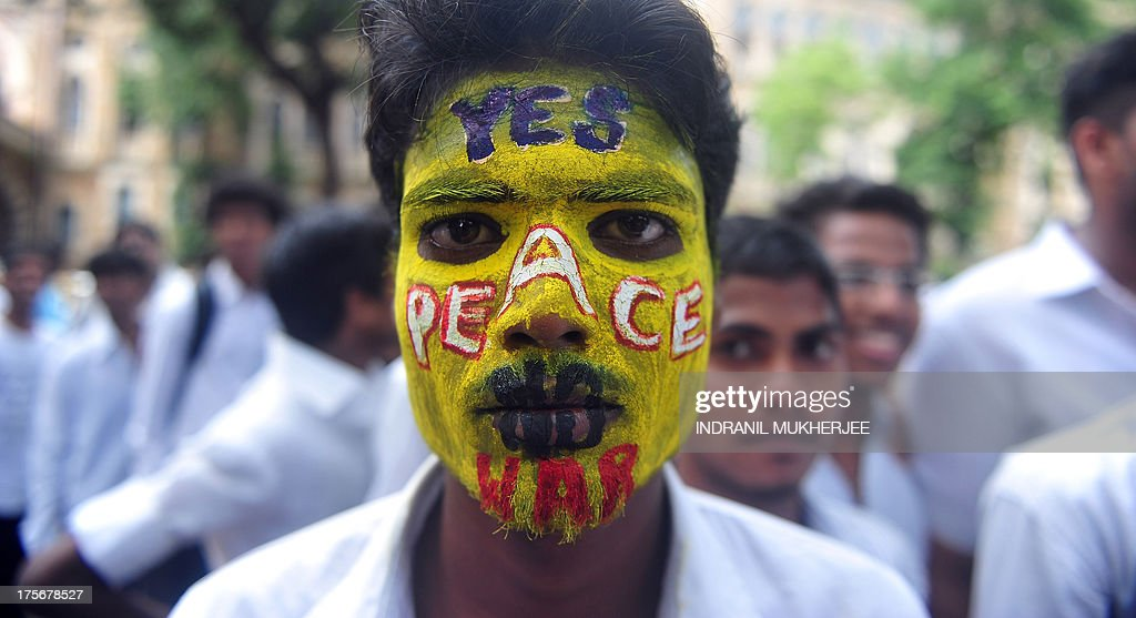 An Indian youth, his face painted with a peace message, takes part in a rally to mark Hiroshima Day in Mumbai on August 6, 2013, to mourn victims of the atomic bombing of Hiroshima in 1945. Peace rallies and memorial services the world over marked the world's first nuclear attack on Hiroshima- the moment 68 years ago when a single US bomb instantly killed more than 140,000 people and fatally injured tens of thousands of others with radiation or horrific burns. AFP PHOTO/Indranil MUKHERJEE