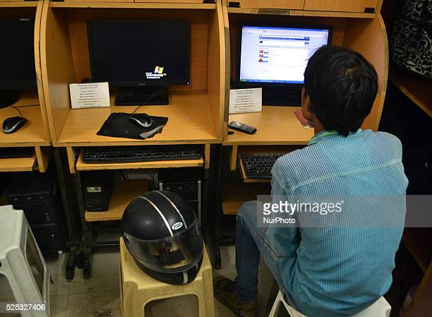 An Indian youth uses the internet at a cyber cafe in Allahabad India Aug4 2015 India has ordered Internet service providers to block access to more...