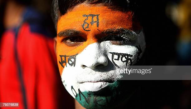 An Indian youth with his face painted with the Indian tricolor takes part in a peace rally on the 60th anniversary of Mahatma Gandhi's assassination...