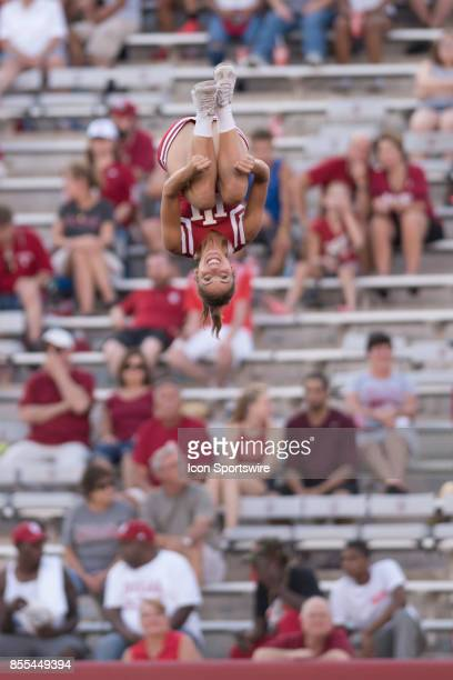 An Indiana cheerleader smiles as she spins in the air during a college football game between the Georgia Southern Eagles and the Indiana Hoosiers on...