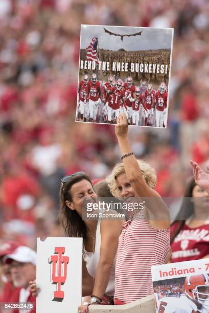 An Indiana fan holding a 'Bend the knee Buckeyes' Game of Thrones meme sign during a college football game between the Ohio State Buckeyes and the...