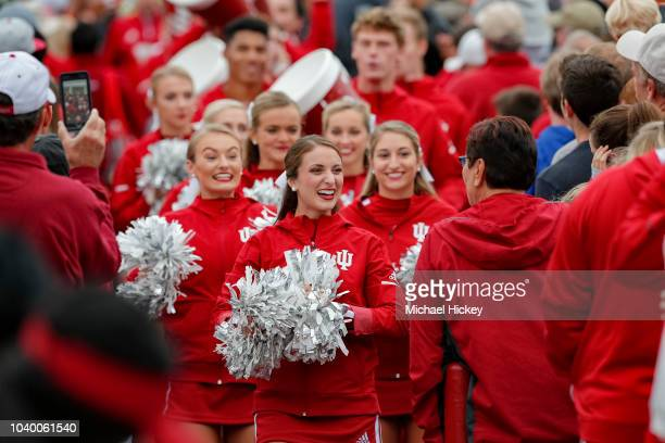 An Indiana Hoosiers cheerleader is seen before the game against the Michigan State Spartans at Memorial Stadium on September 22 2018 in Bloomington...