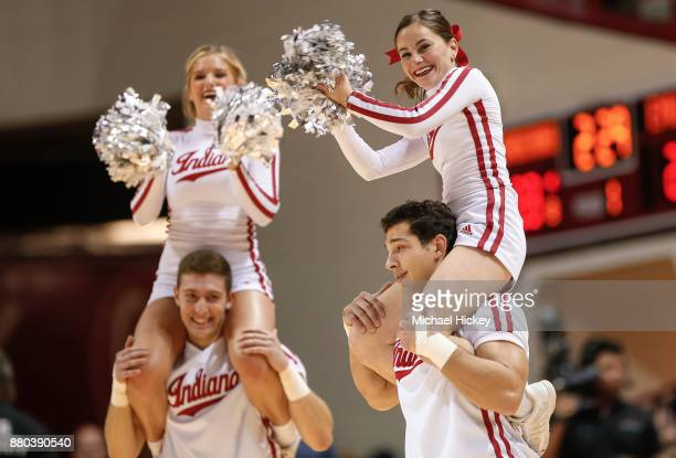 An Indiana Hoosiers cheerleader is seen during the game against the Eastern Michigan Eagles at Assembly Hall on November 24 2017 in Bloomington...