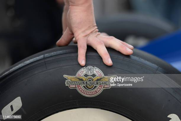An Indianapolis Motor Speedway Centennial Era logo is displayed on a tire of the IndyCar driver Graham Rahal of the United Rentals Rahal Letterman...