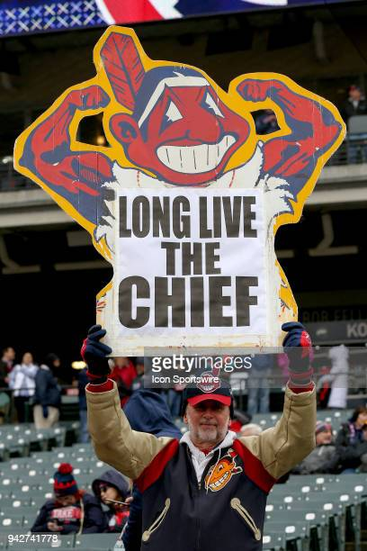 An Indians fan holds up a Chief Wahoo sign primo to the Major League Baseball home opener between the Kansas City Royals and Cleveland Indians on...