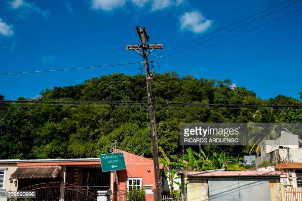 An indicative road sign towards the Arecibo Observatory is seen on a rural road in Arecibo, Puerto Rico on December 1, 2020. - The Arecibo...