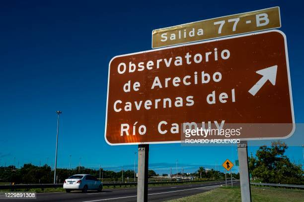 An indicative road sign towards the Arecibo Observatory is seen on the highway in Arecibo, Puerto Rico on December 1, 2020. - The Arecibo Observatory...