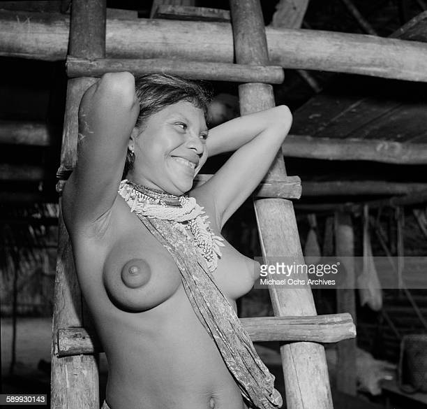 An Indigenous 'Amerindian' woman poses in her hut in Suriname