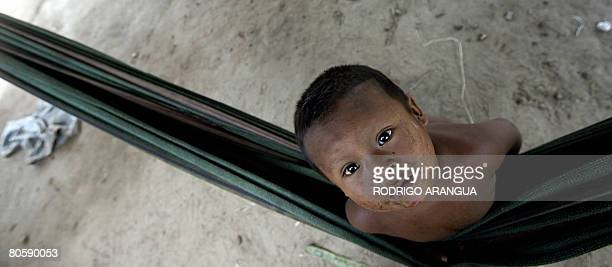 An indigenous boy belonging to the Nukak-Maku ethnic group, the last nomadic people of Colombia, plays in a hammock on April 7 in a provisional...