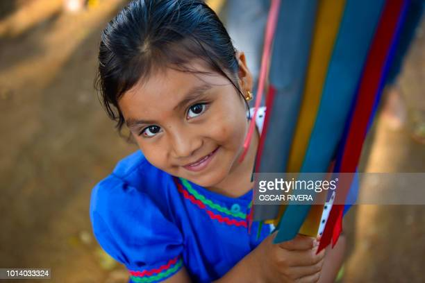 An indigenous girl attends a ceremony commemorating the International Day of the World's Indigenous Peoples at El Llanito in Izalco 70 km west of San...