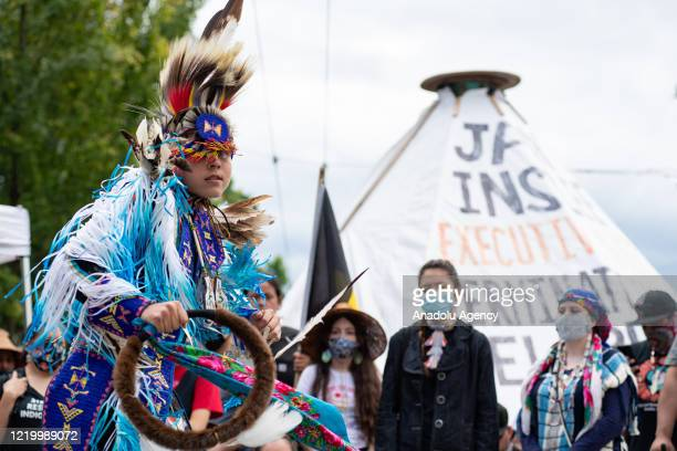 An indigenous grass dancer performs inside the âCapitol Hill Organized Protestâ formerly known as the âCapitol Hill Autonomous Zoneâ in Seattle,...