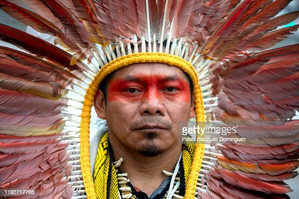 An Indigenous man called Ninawa from the Huni Kui people takes part in a protest outside REPSOL Headquarters on December 08, 2019 in Madrid, Spain....