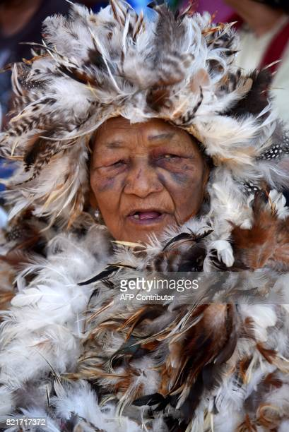 An indigenous man dressed in a costume made of hen feathers pays tribute to the patron saint of the indigenous people San Francisco Solano during the...