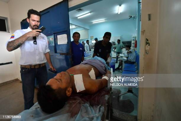 An indigenous man injured during clashes with Venezuelan soldiers arrives at the hospital in Boa Vista Roraima State Brazil on February 22 2019...