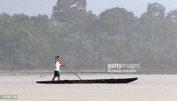 An indigenous man navagates along the Napo River as it runs through the Yasuni National Park in the Ecuadorean Amazon region 300 km east of Quito on...