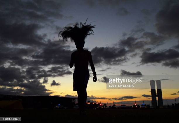 TOPSHOT An indigenous man protests outside the National Congress building in Brasilia Brazil on April 24 2019 Approximately 2000 indigenous people...