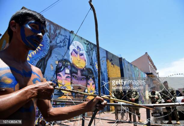 An indigenous man takes part in a demonstration in front of the presidential palace in Asuncion on December 18 2018 to demand the resignation of the...