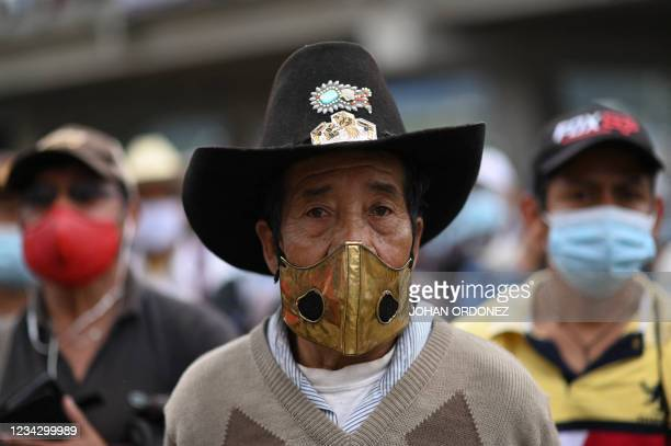 An indigenous man takes part in a roadblock demanding the resignation of Guatemalan President Alejandro Giammattei and Guatemala's Attorney General...