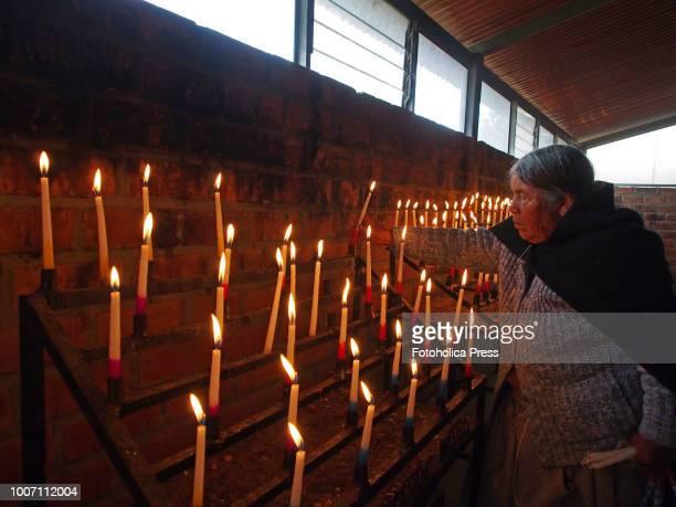 SAPALLANGA HUANCAYO JUNIN PERU An indigenous old woman lights a candle for the virgin of Cocharcas in the church of Sapallanga in the city Huancayo...
