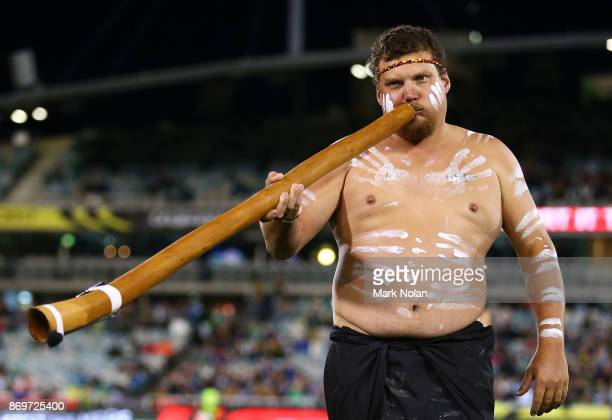 An indigenous performer plays the Didgeridoo before the 2017 Rugby League World Cup match between Australian Kangaroos and France at Canberra Stadium...