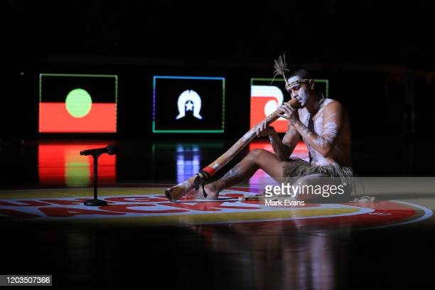 An Indigenous performer plays the didgeridoo during the round 18 NBL match between the Illawarra Hawks and the New Zealand Breakers at WIN...