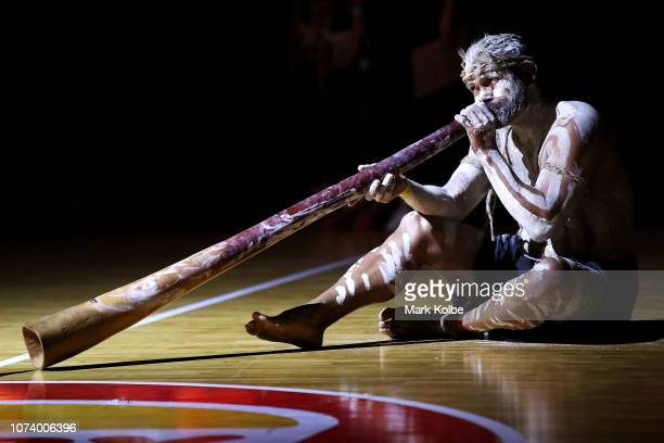 An indigenous performer plays the didgeridoo during the welcome ceremony before the round nine NBL match between the Illawarra Hawks and the Sydney...