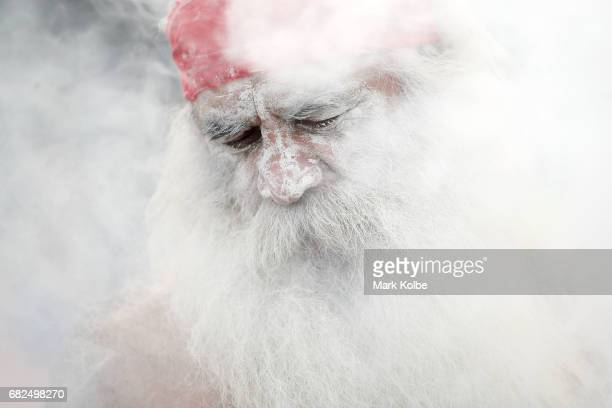 An indigenous performer prepares for a smoking ceremony to commemorate Indigenous Round ahead of the round 10 NRL match between the Penrith Panthers...
