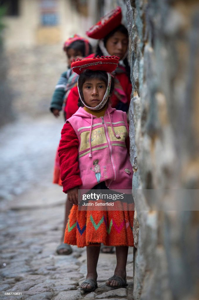 An indigenous Peruvian girl in traditional dress in the Incan city of Cusco, on January 15, 2014 in Cusco, Peru. The historic town of Cusco lies high in the Andes and is the typical rest-stop for tourists bound for Machu Picchu.