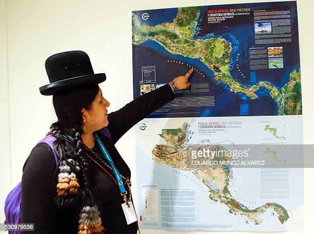 An indigenous woman from Bolivia looks at the new high Indigenous tech map on May 12 at the United Nations Headquarters in New York The new high tech...