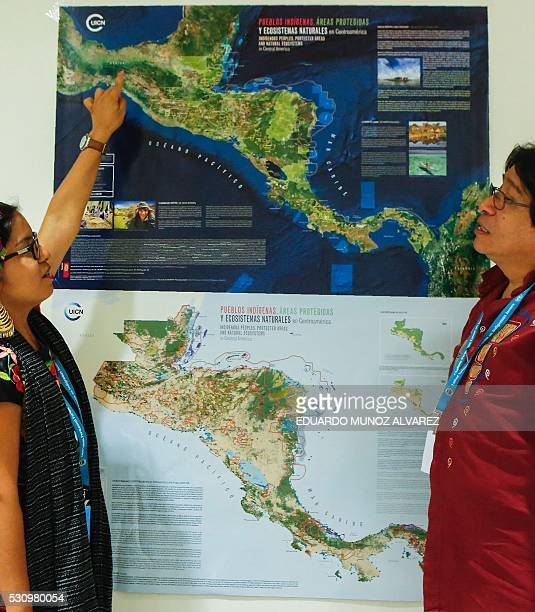 An indigenous woman from Mexico speaks with Amadeo Martinez President of the Indigenous Council of Central America after taking part in a press...