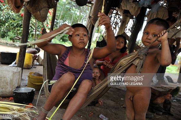 An indigenous woman from the Nukak Maku ethnic group, the last nomadic people of Colombia, knits handicrafts on April 13 at a settlement in Agua...