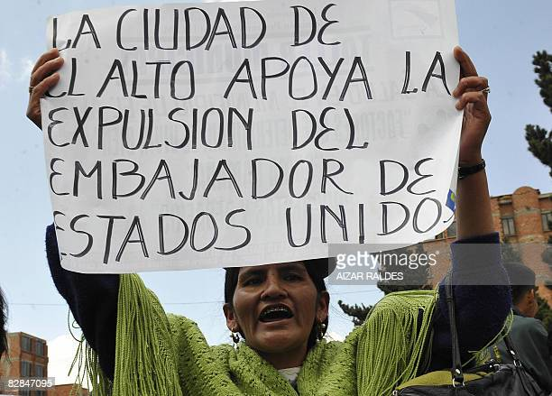 An indigenous woman holds a sign supporting the expulsion of the US ambassador during a demonstration in the surroundings of the military airport in...