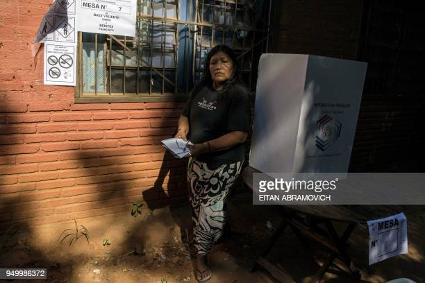 An indigenous woman member of Maka tribe votes at a polling station in Mariano Roque Alonso outskirts of Asuncion on April 22 during Paraguay's...