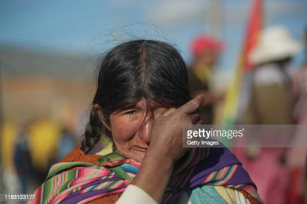 An indigenous woman prays and cries during a blockade to a Yacimientos Petroliferos Fiscales Bolivianos oil refinery as part of a protest against the...
