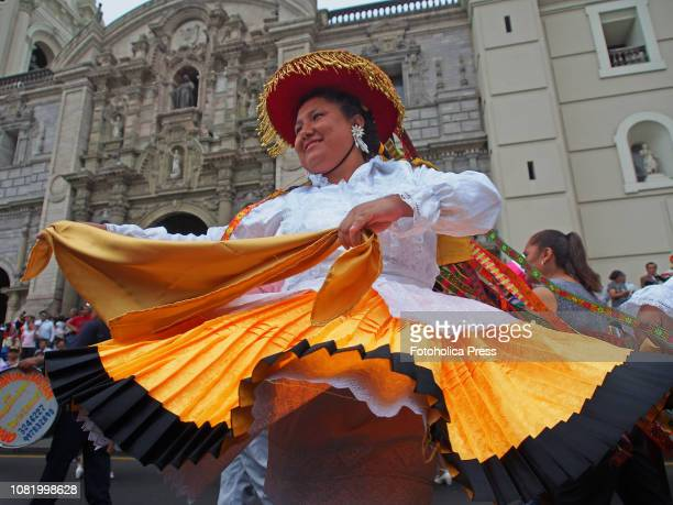 An indigenous woman wearing andean typical costume dancing when hundreds of Quechuaspeaking Indigenous people devotees of San Sebastian carry on a...