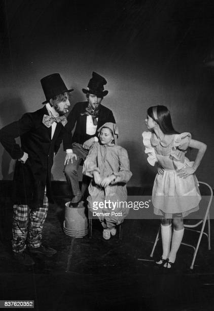 An indignant Alice played by Julie White right confronts three of Lewis Carroll's most improbable characters in this scene from the Bonfils...