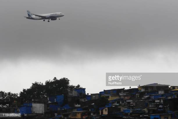 An IndiGo aircraft prepares to land at airport in Mumbai India on 10 July 2019 Shares of Indias largest airline crashed around 19 per cent on NSE to...