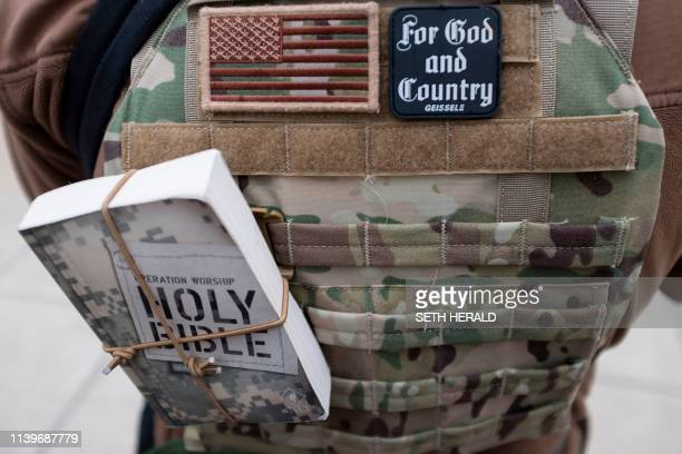 TOPSHOT An individual attends the ProFreedom rally at the Indiana State House on Saturday April 272019 near the Indiana Convention Center where the...