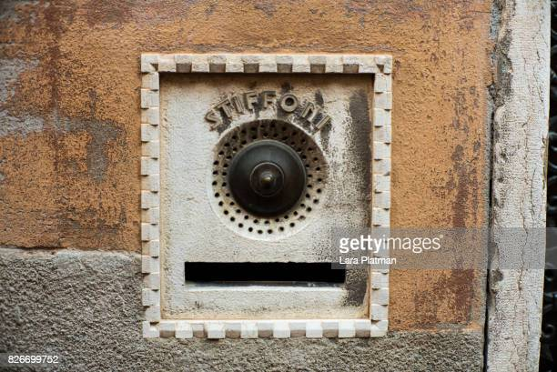 an individual doorbell in venice italy, - lara platman stock pictures, royalty-free photos & images