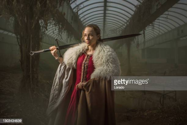 an individual fairytale warrior princess indoors - historical clothing stock pictures, royalty-free photos & images