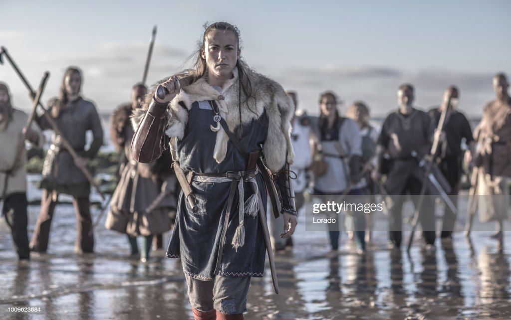 An individual female viking warrior in action on a watery battlefield : Stock Photo