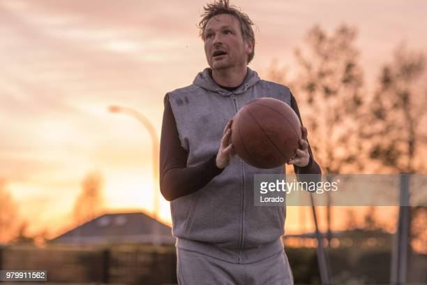 an individual male player of a basketball team during a street ball training session - amateur stock pictures, royalty-free photos & images
