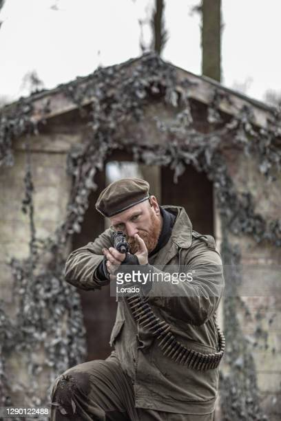 an individual military male during an outdoor operation - historical clothing stock pictures, royalty-free photos & images