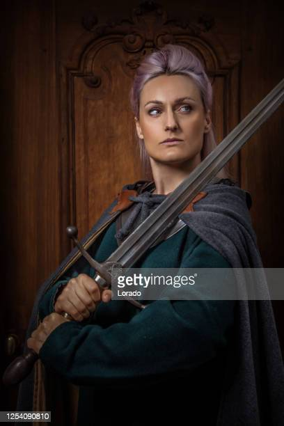 an individual viking female in a hall - historical clothing stock pictures, royalty-free photos & images
