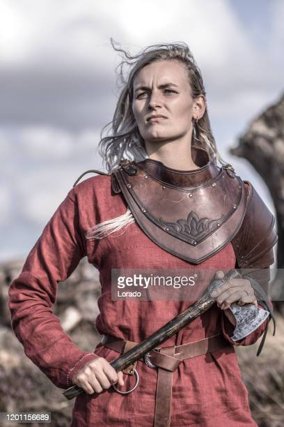 an individual viking female warrior outdoors - warrior person stock pictures, royalty-free photos & images