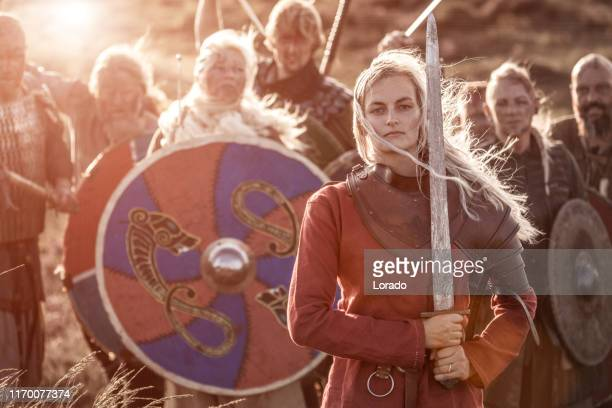an individual viking female warrior princess outdoors - reenactment stock photos and pictures